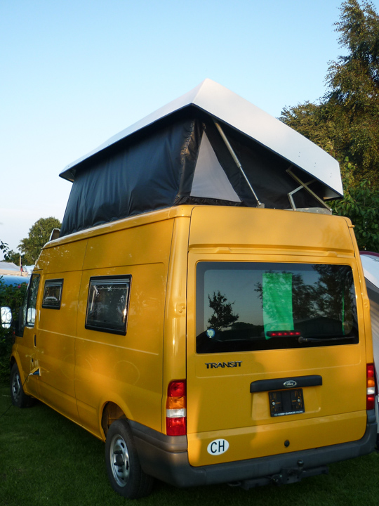 Folding roof for a Ford Transit